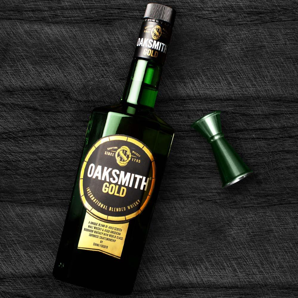 oaksmith gold bottle with jigger and peg measurer