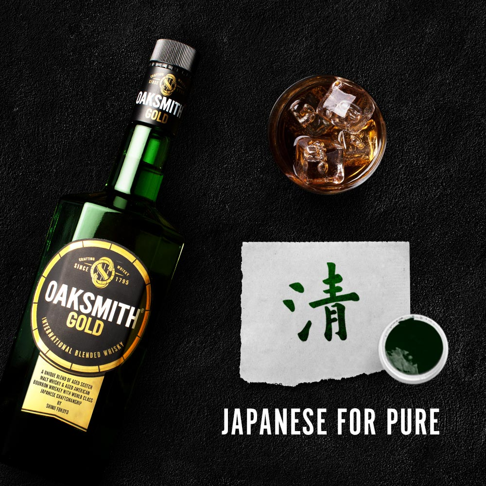 oaksmith gold bottle with gold written in japanese on table top