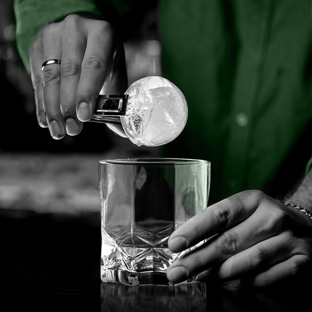bartender making a drink with oaksmith gold