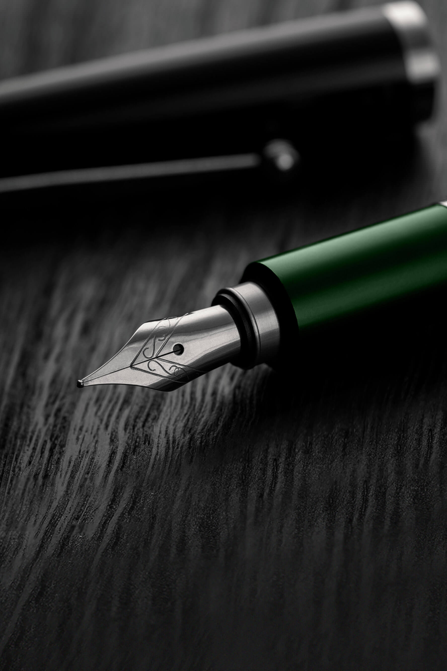 oaksmith gold international premium pen on table top
