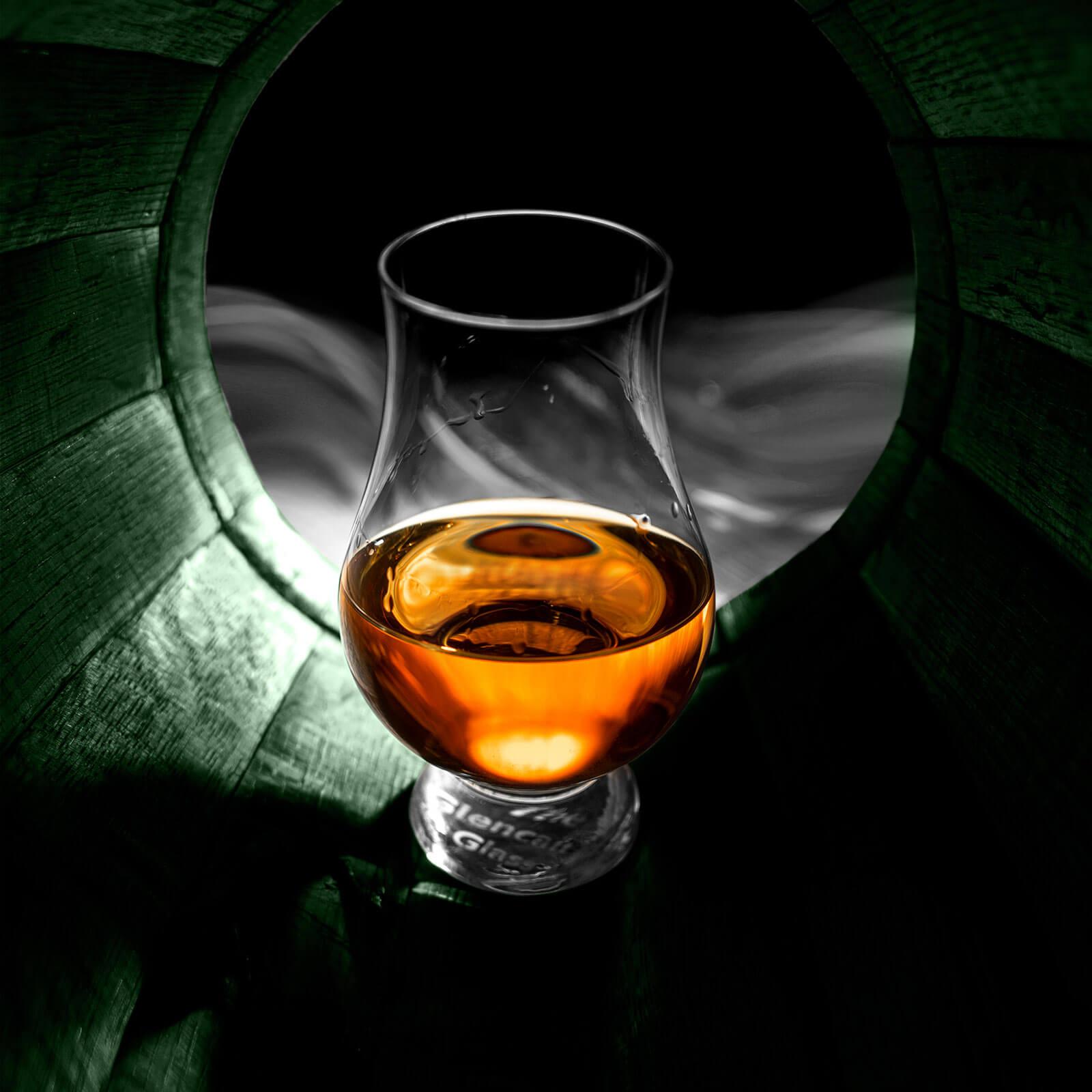 glass with oaksmith internationalinside a barrel